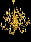 Golden antique chandelier isolated in black — Stock Photo