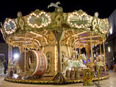 An old fashioned carousel at night — Stock Photo