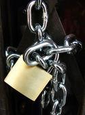 Key lock locked with a chain — Stock Photo