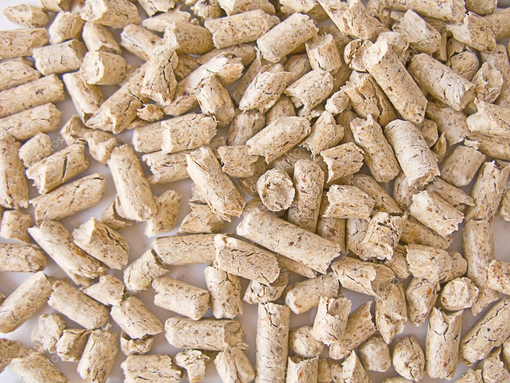 Wood pellets background close up isolated in white