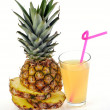Glass of fresh pineapple juice and fruit — Stock Photo