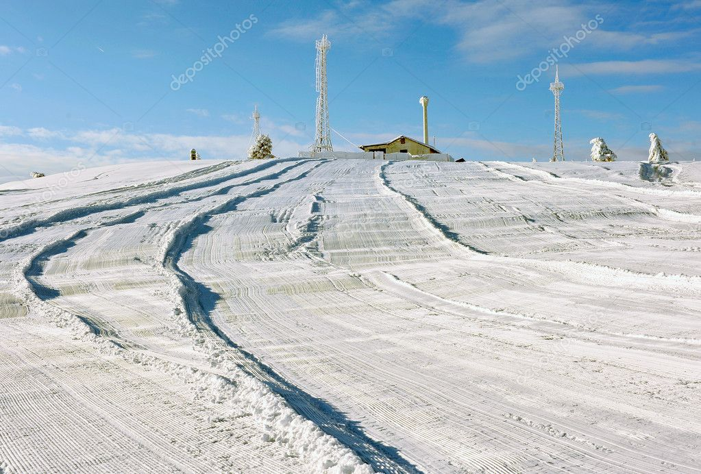 Snow pattern made by snowplow on a ski slope — Stock Photo #6145065