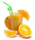 Glass of fresh orange juice and fruits — Stock Photo