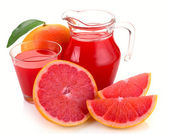 Grapefruit juice and fruit — Stock Photo