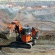 Panorama of the iron ore quarry with an excavator — Stock Photo