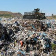 Stock Photo: Bulldozer on garbage dump