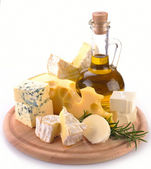 Collection of cheeses and olive oil — Stock Photo