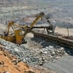 Loading of iron ore on the train — Stock Photo