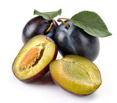 Plum and a half and leaves — Stock Photo