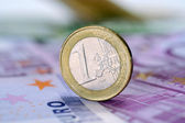 Coin one euro at EUR 500 banknotes — Stock Photo