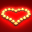 Heart from burning candles — Stock Photo