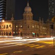 Night scene at a busy road intersection in Kuala Lumpur, Malaysia, with car — Stock Photo