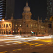 Night scene at a busy road intersection in Kuala Lumpur, Malaysia, with car - Stock Photo