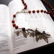 Stock Photo: Red rosary and holy bible