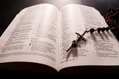 Red rosary and holy bible — Stock Photo