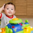 6 month old Asian baby girl plays sitting in a walker — Stock Photo