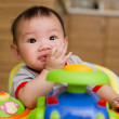 6 month old Asian baby girl chewing her fingers — Stock Photo #6362033