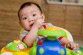 6 month old Asian baby girl chewing her fingers — Stock Photo