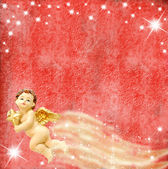 Angel and stars on red background — Stockfoto