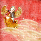 Angel with violin on red background — Stock Photo