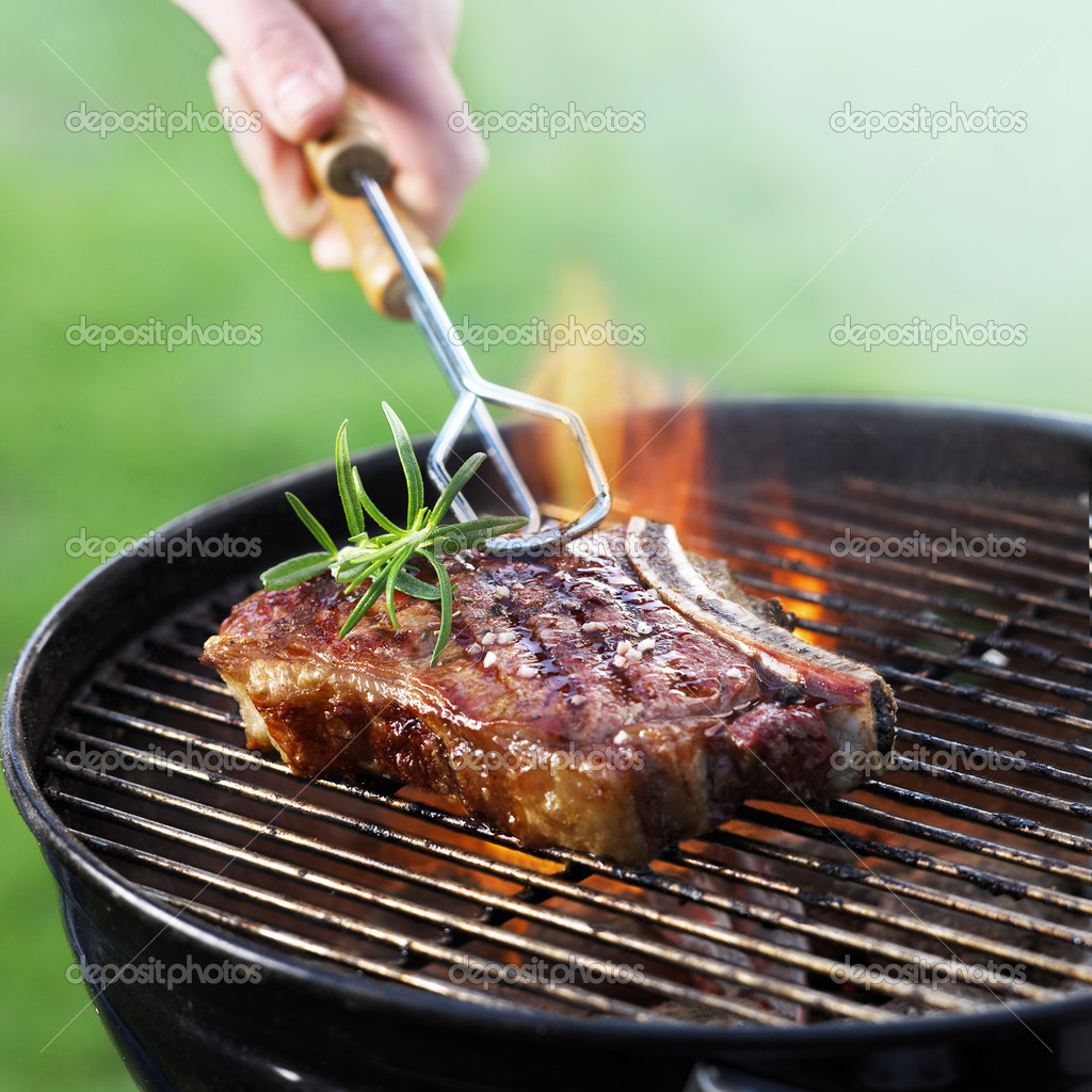 Flames grilling a steak on the BBQ  Stock Photo #6142892