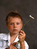 The nice boy with the flowers — Стоковое фото