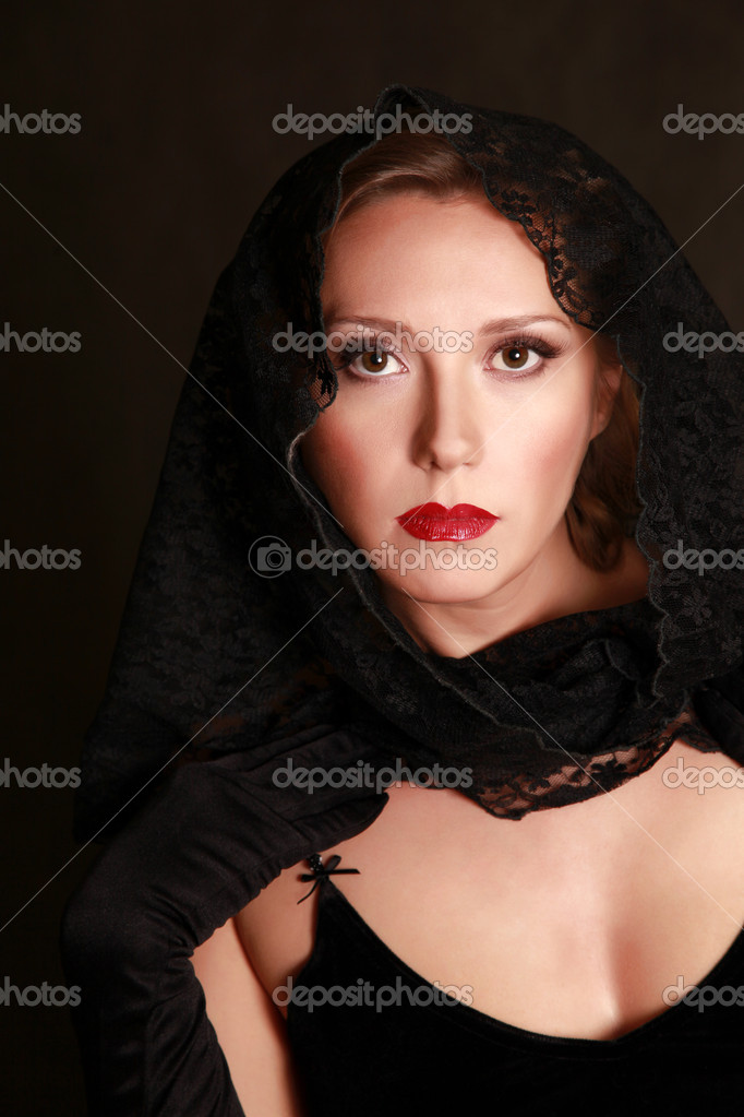 Beautiful woman closed by a black fabric — Stock Photo #6157979