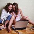Girls with a computer — Stock Photo