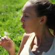 Girl with a dandelion — Stock Photo #6166608