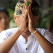 Indonesian groom prays - Stock Photo