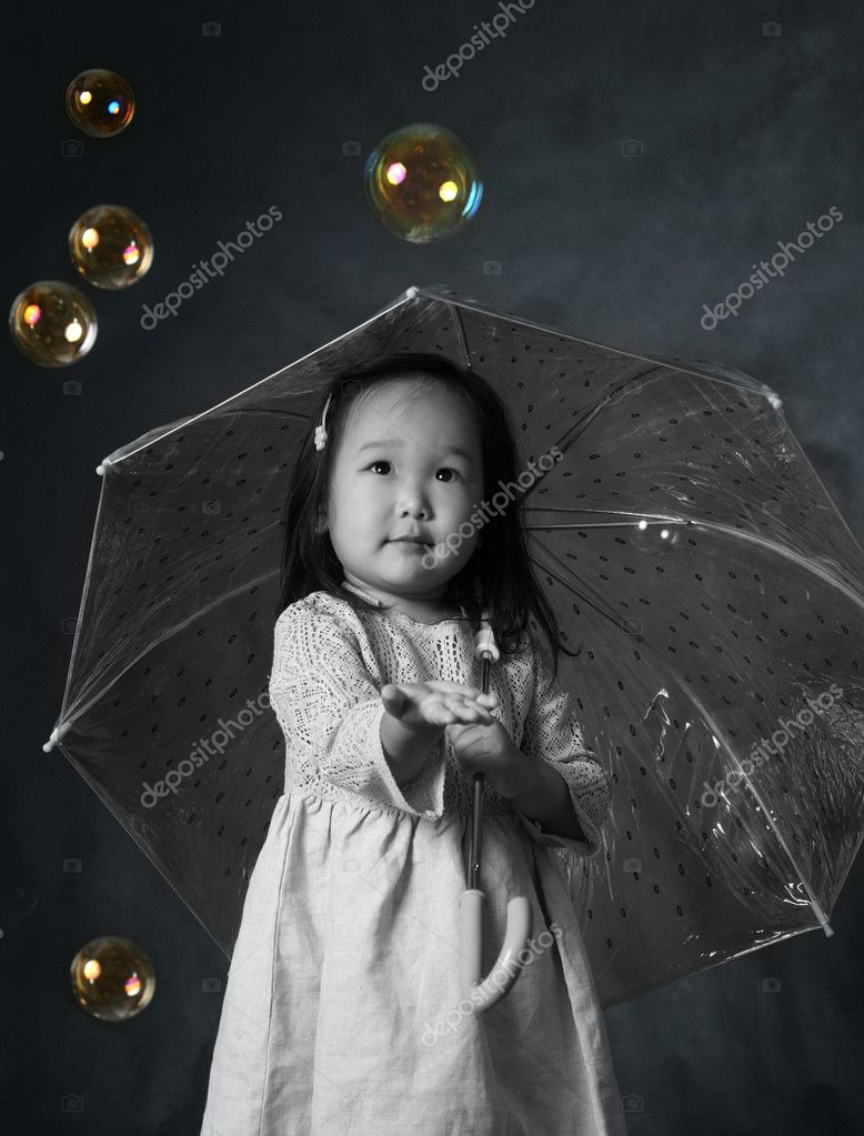 The small Korean girl with a umbrella and soap bubbles — Stock Photo #6169519