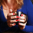 Stock Photo: Hand with glass of tea