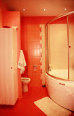 Modern red bathroom — Stock Photo