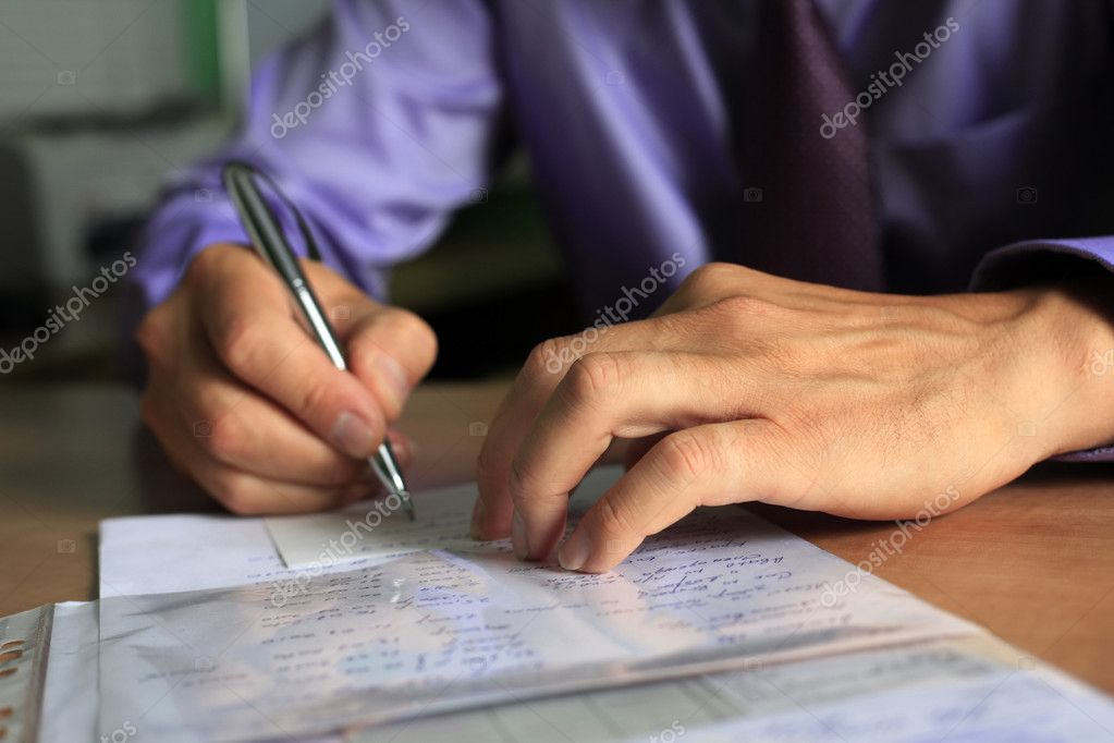 Hand of the businessman with pen  Stock Photo #6170717