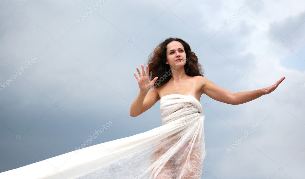 The girl in a white fabric on a background of the sky — Stock Photo #6171905