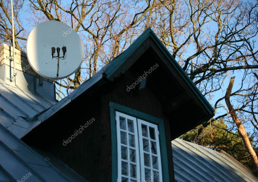 Satellite dish of TV on a roof on a background of the sky — Stock Photo #6177675