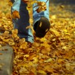 The man goes on yellow foliage — Stock Photo
