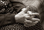 Hands of the elderly woman — Stock Photo
