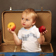 Stock Photo: Boy with a apples