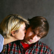 Woman kisses sad the man — Stock Photo