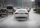 Road in rain — Stock Photo