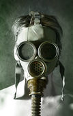 The girl in a gas mask — Stock Photo