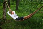 Woman in a hammock — Stock Photo