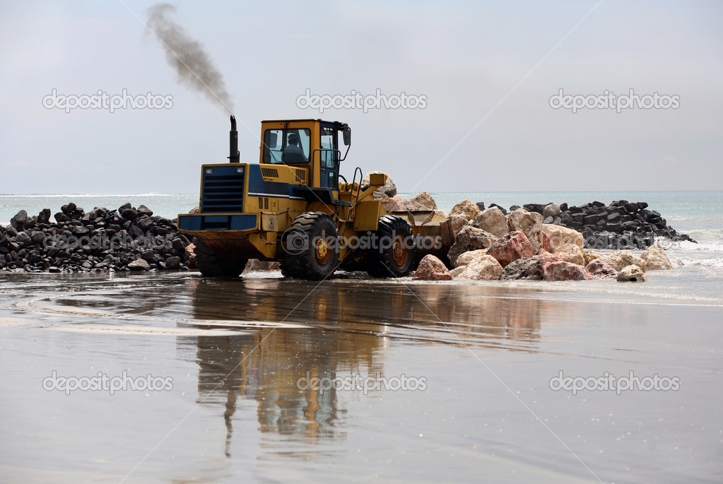A view of a big bulldozer on coastline  Stock Photo #6201164