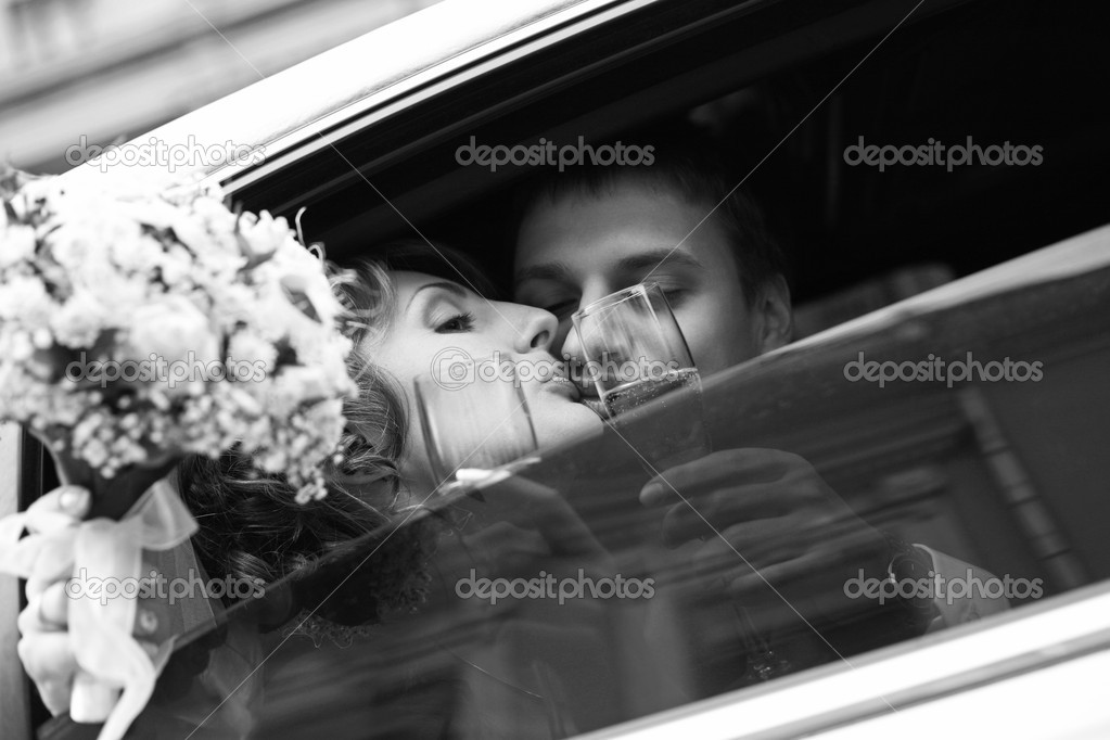 Newly-married couple in car with champagne    #6202579