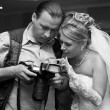 Bride and photographer — Stok fotoğraf