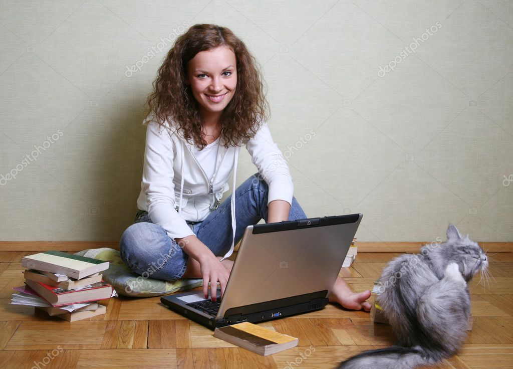 The young girl among books with a computer and cat — Stock Photo #6225238