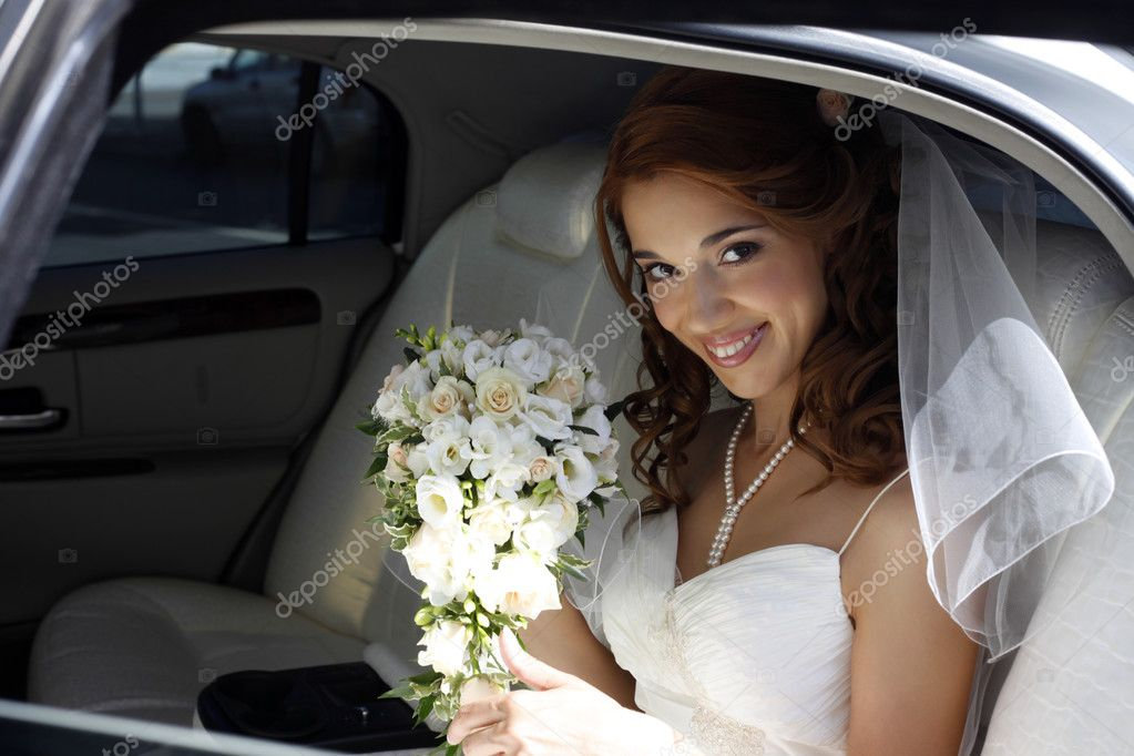The beautiful bride in the automobile  Stock Photo #6231687