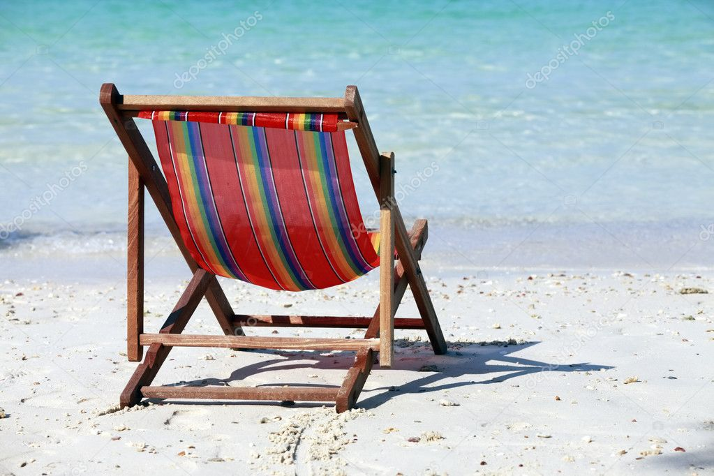 Lonely chaise lounge on a beach — Stock Photo #6257318