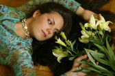 The girl with lilies — Stock Photo